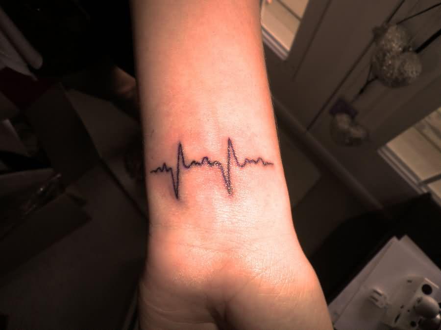 my-favorite-black-ink-heartbeat-tattoo-style-on-wrist