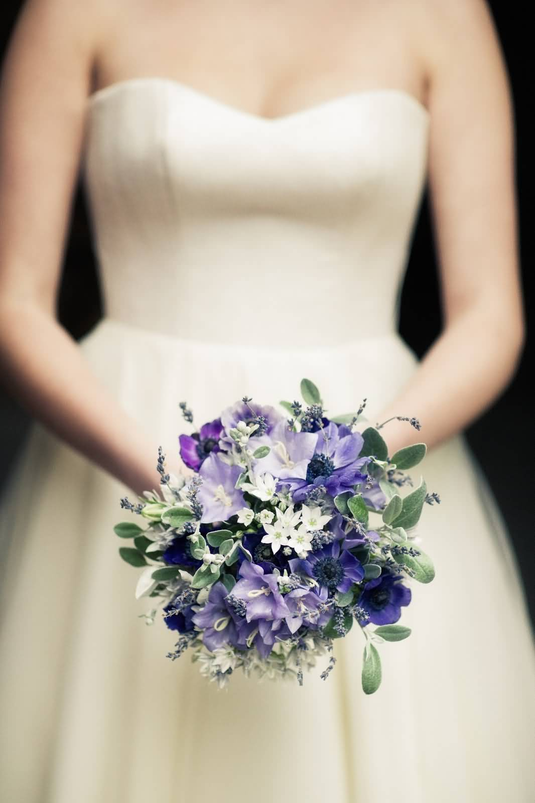 Awesome Bluebell Flower Bouquet In Girl Hands Wallpaper