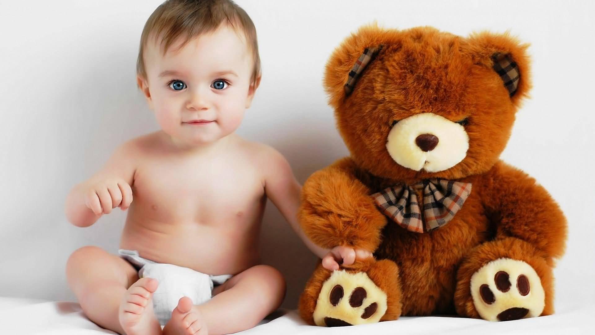 Cute Baby Boy Sitting With His Teddy Bear
