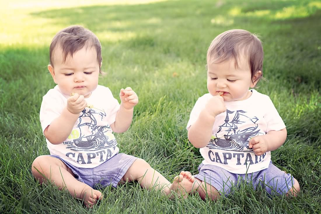 Cute Twin Baby Playing On Ground
