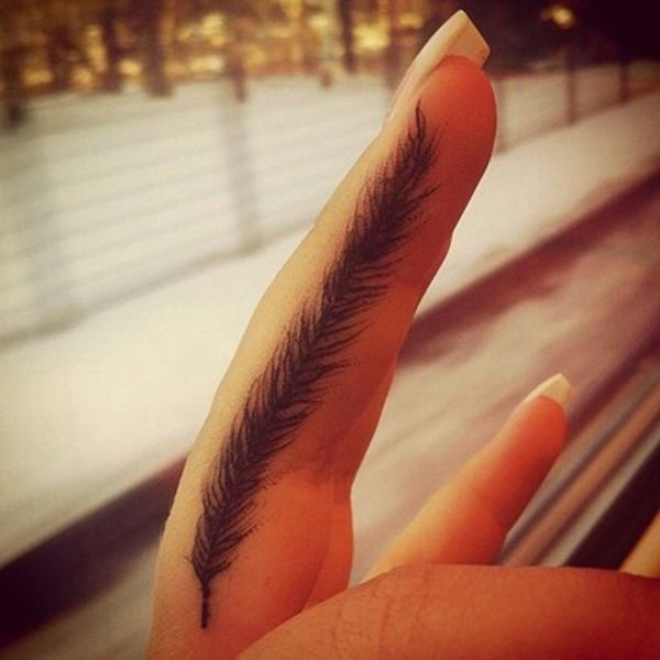 Fabulous Small Feather Tattoo Design For Girl Middle Finger