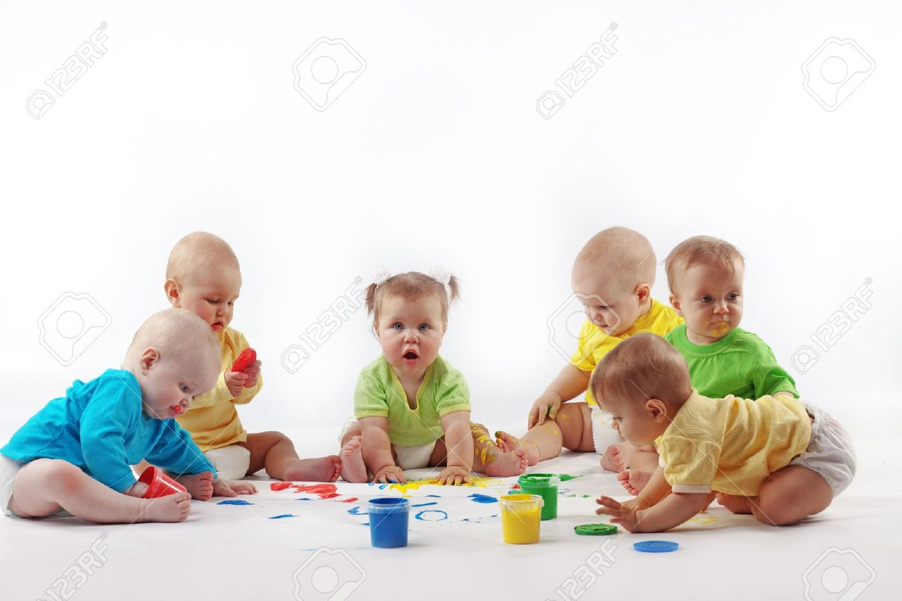 Group Of Babies Playing With Color