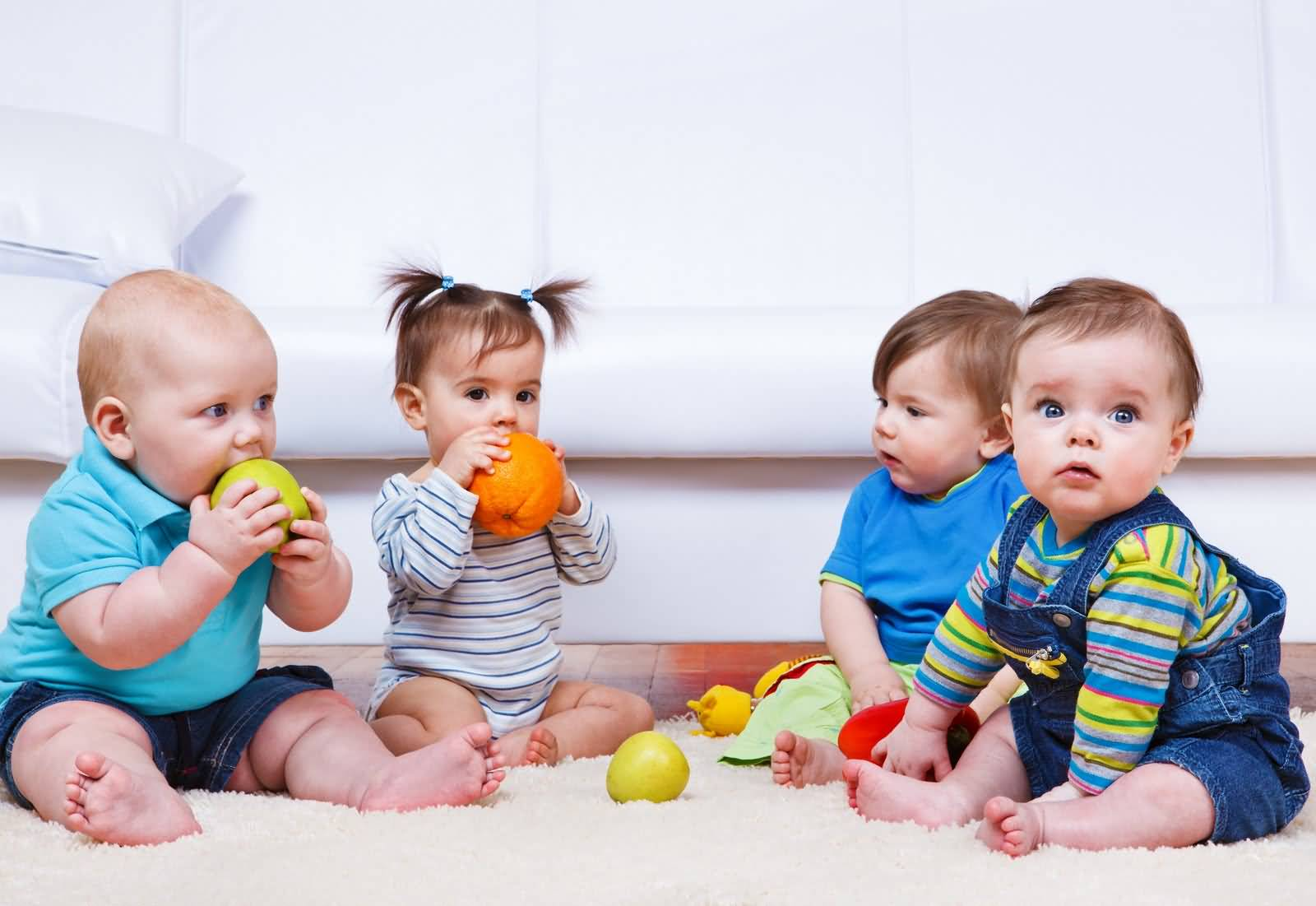 Healthy Babies Playing With Toys