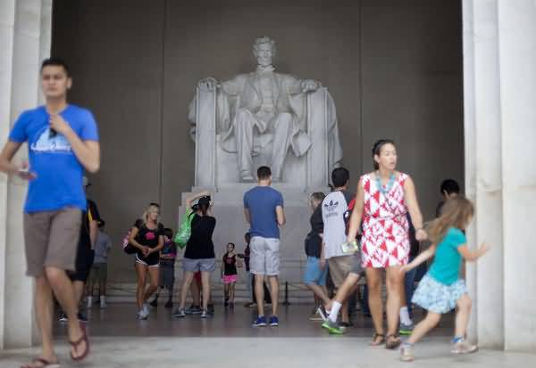 Many People Visit At The Lincoln Memorial And See The Abraham Lincoln Statue