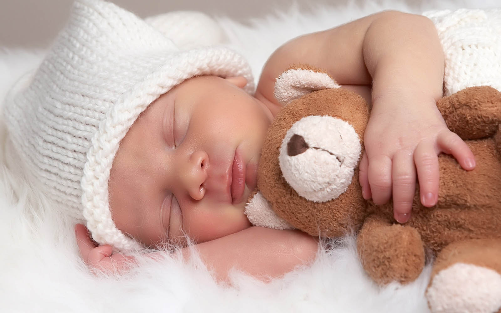 Sleeping Cute Little Baby With Teddy Bear