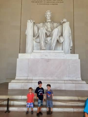 Three Litle Boys Posing For Snape In Front Of Statue Inside The Lincoln Memorial