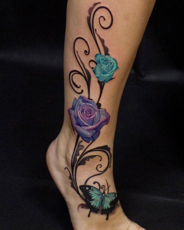 amazing-rose-and-butterfly-calf-tattoo-with-colourful-ink