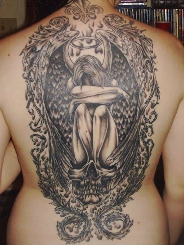 best ever black color ink angel tattoo on girl back cover for women made by expert artist