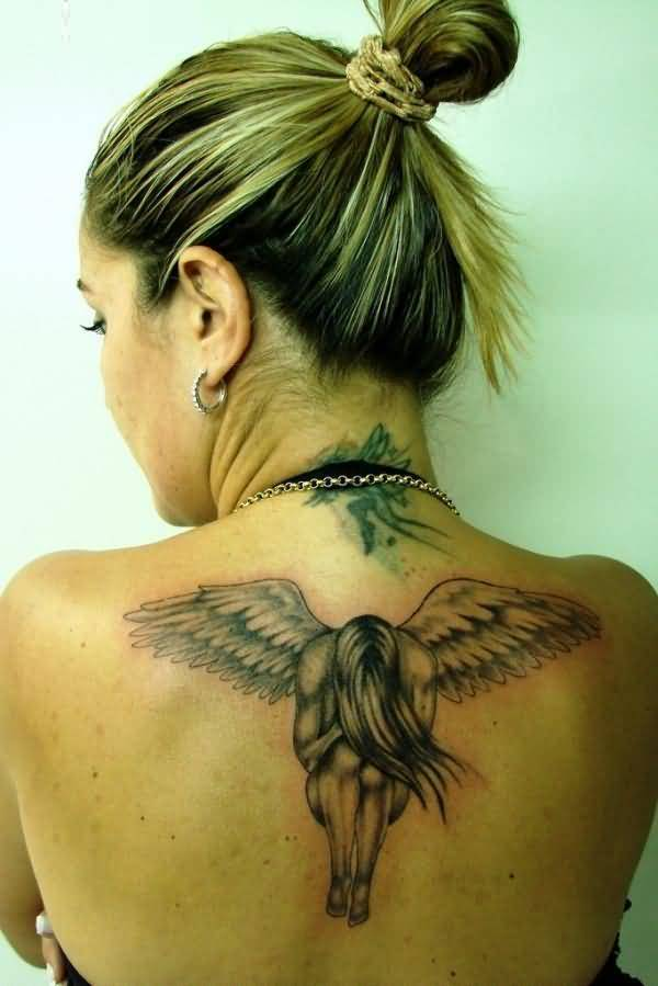 cute red and black color ink angel tattoo on girl back cover for girls made by expert