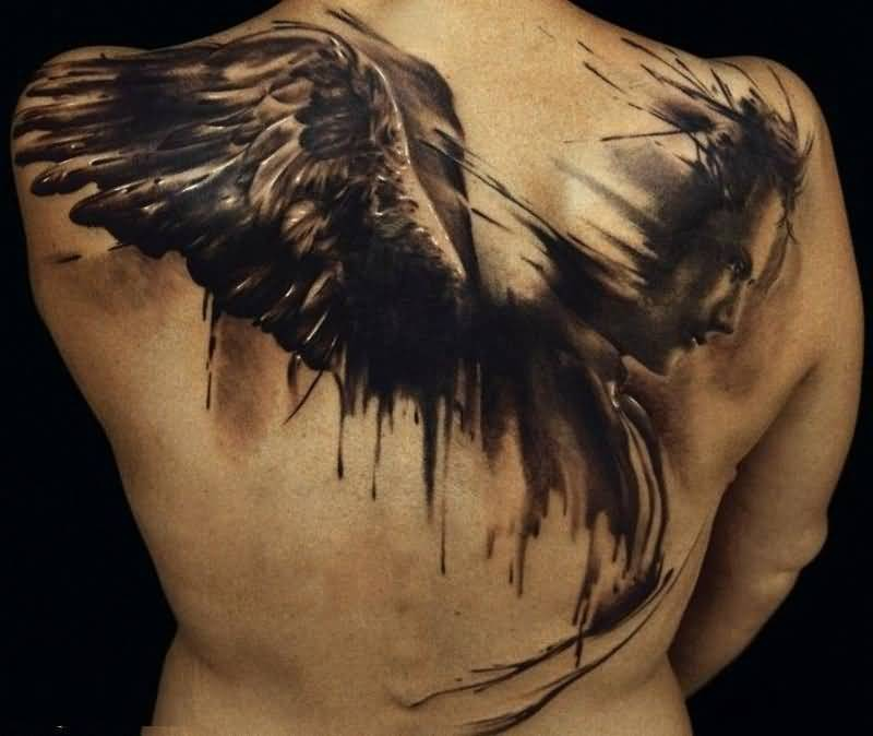 extremely black color ink angel tattoo on girl back cover for girls made by expert women