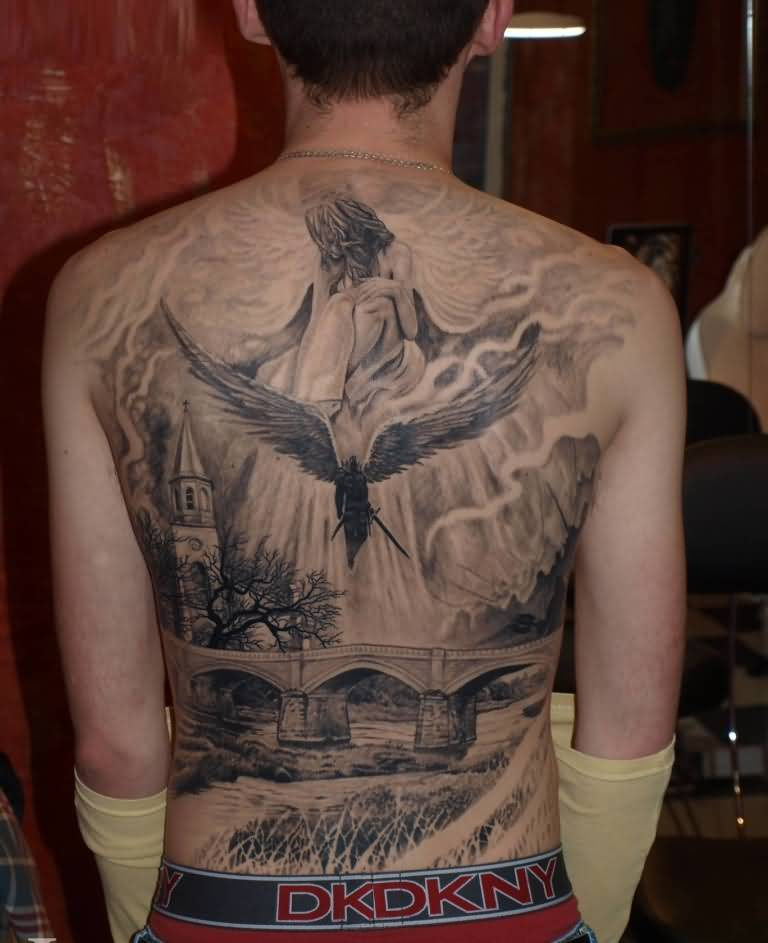 fabulous black color ink angel tattoo on boy back cover for boys made by expert artist