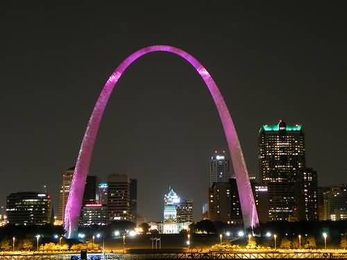 Lovely Pink Light On The Gateway Arch At Night With Beautiful Buildings