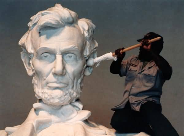 One Worker Cleaning Abraham Lincoln Statue Inside The Lincoln Memorial