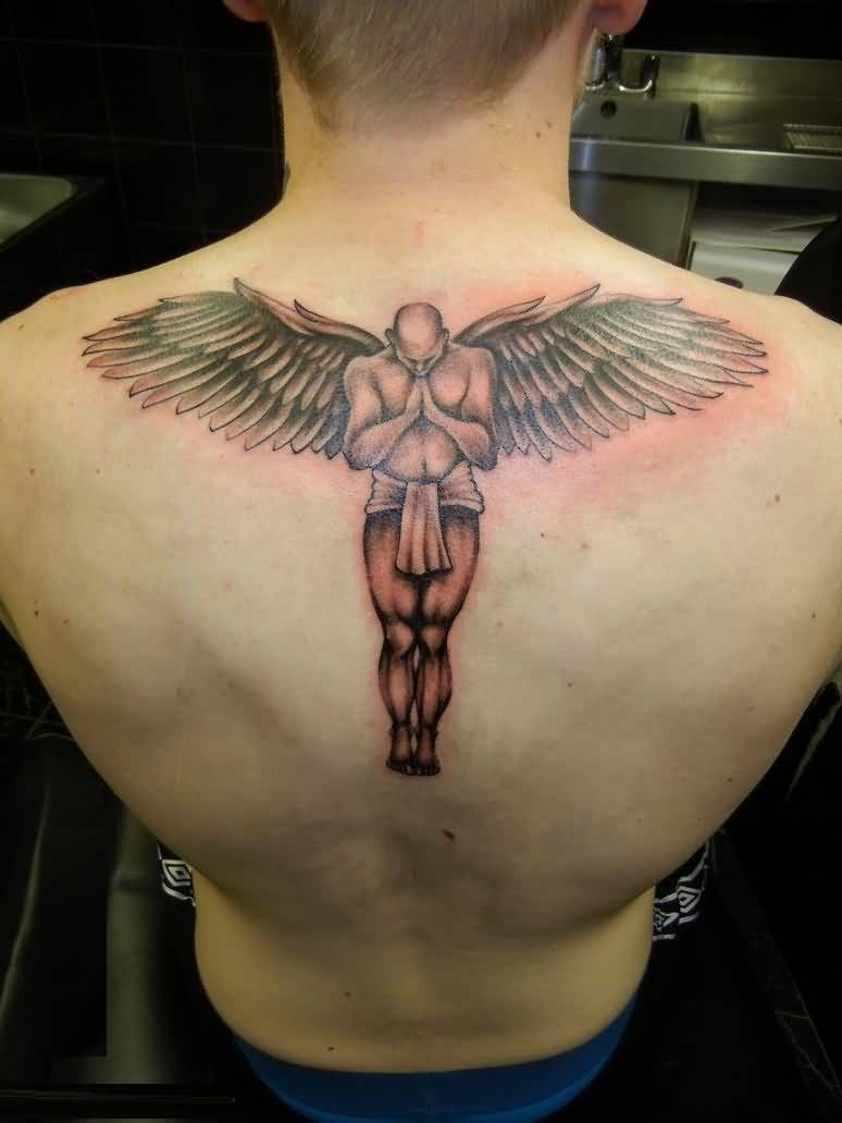 perfect red light color ink angel tattoo on boy back cover for boys made by expert artist