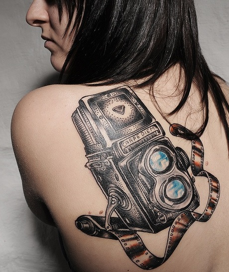 Adorable Black And Red Color Ink Camera With Film Tattoo On Back Shoulder For Girls
