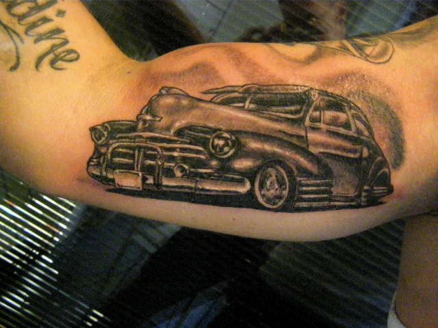 Adorable Black And Red Color Ink Low Rider Car Tattoo On Muscles For Boys