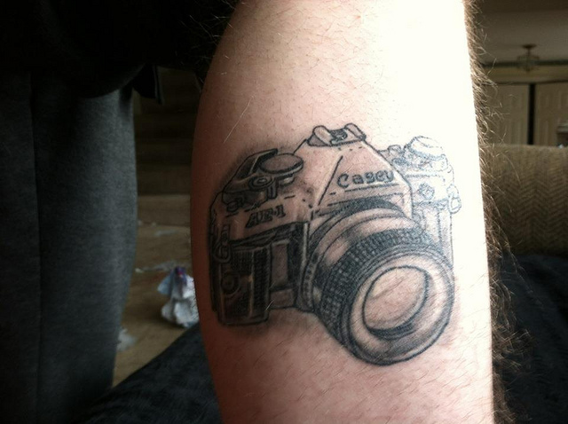 Amazing Black Color Ink Canon Camera Tattoo Design On Leg for Girls