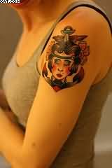 Amazing Red And Black Color Ink Anchor Sign With Face Tattoo On Shoulder For Girls