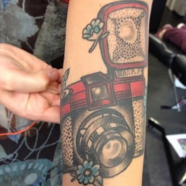 Awesome Black And Red Color Ink Camera Tattoo On Arm For Girls