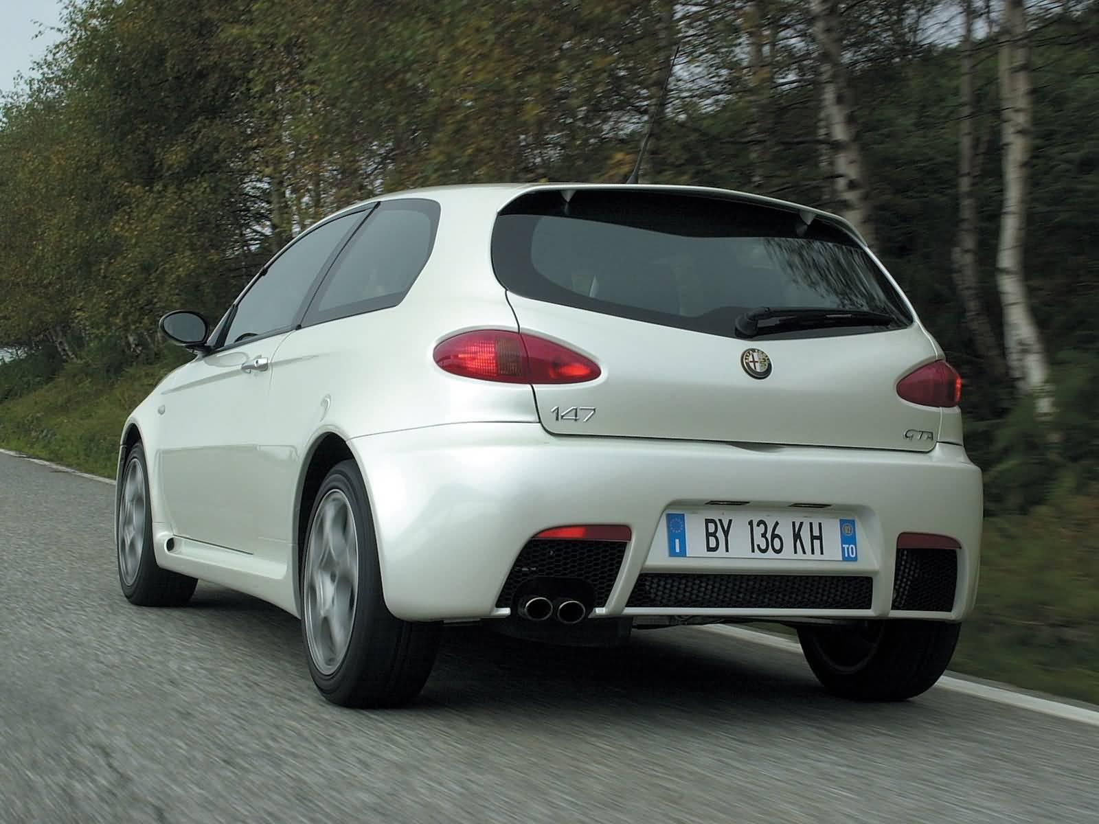 Back side of beautiful white colour Alfa Romeo 147 GTA Car on the road