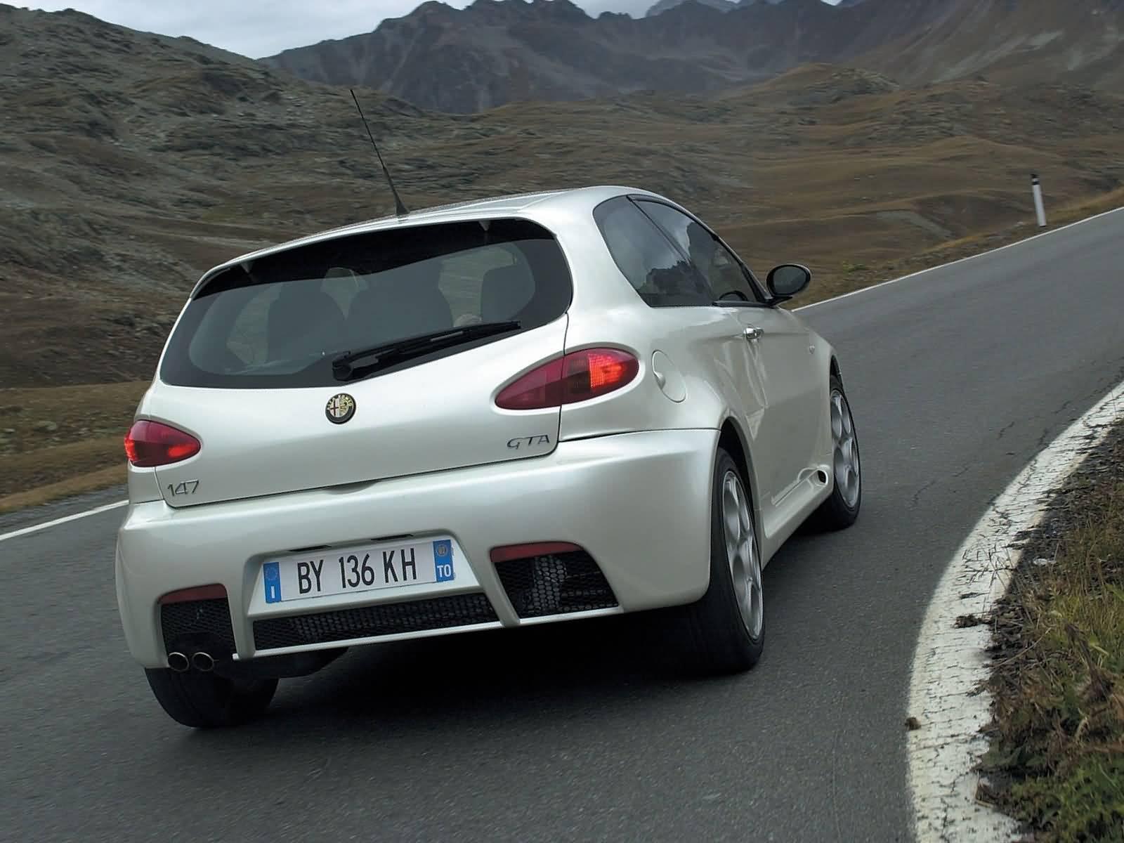 Back side view of beautiful White colour Alfa Romeo 147 GTA Car on the road