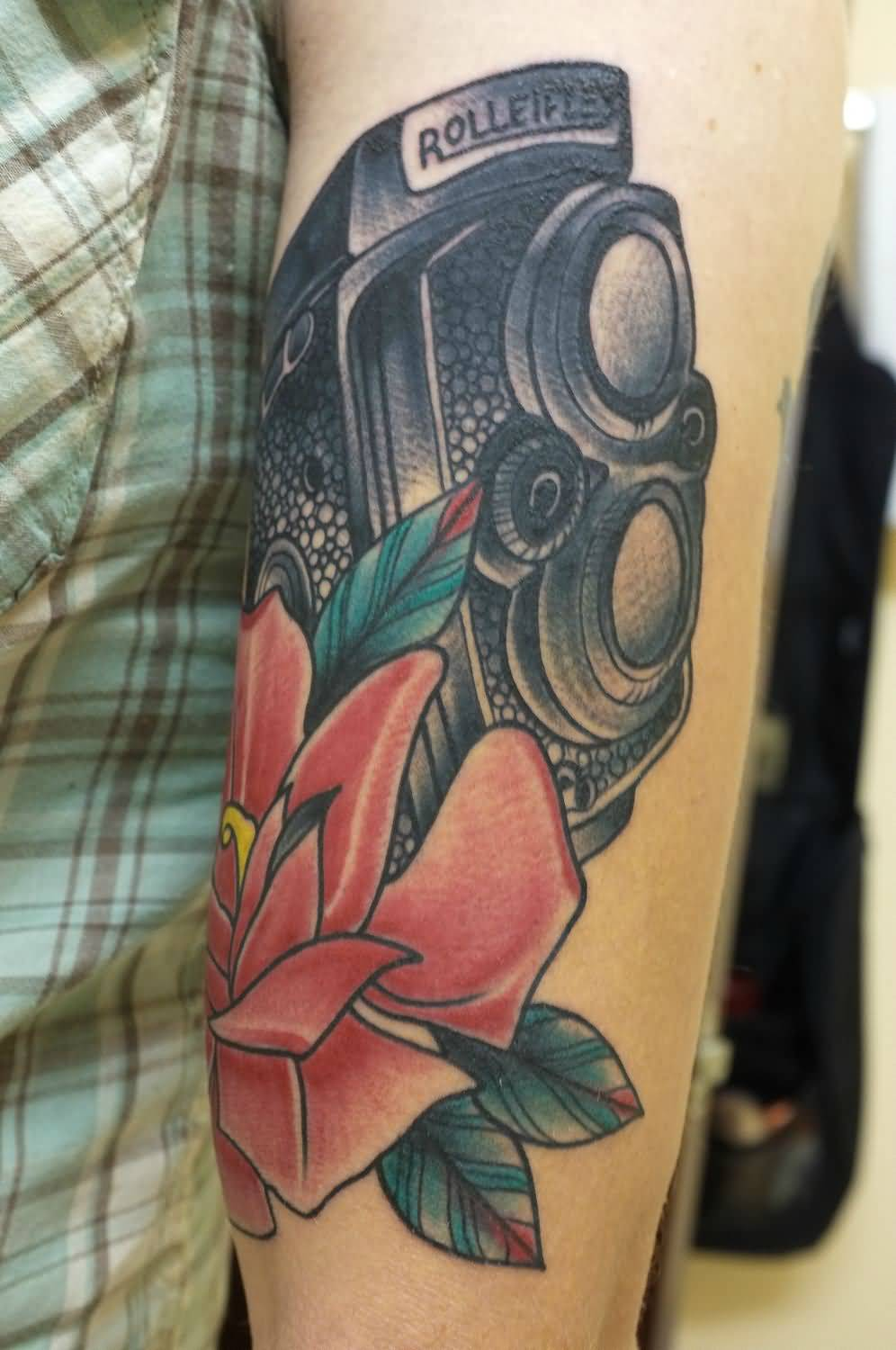 Cool Blue Black And Red Color Ink Rolleiflex Camera Tattoo With Flower On Arm For Boys