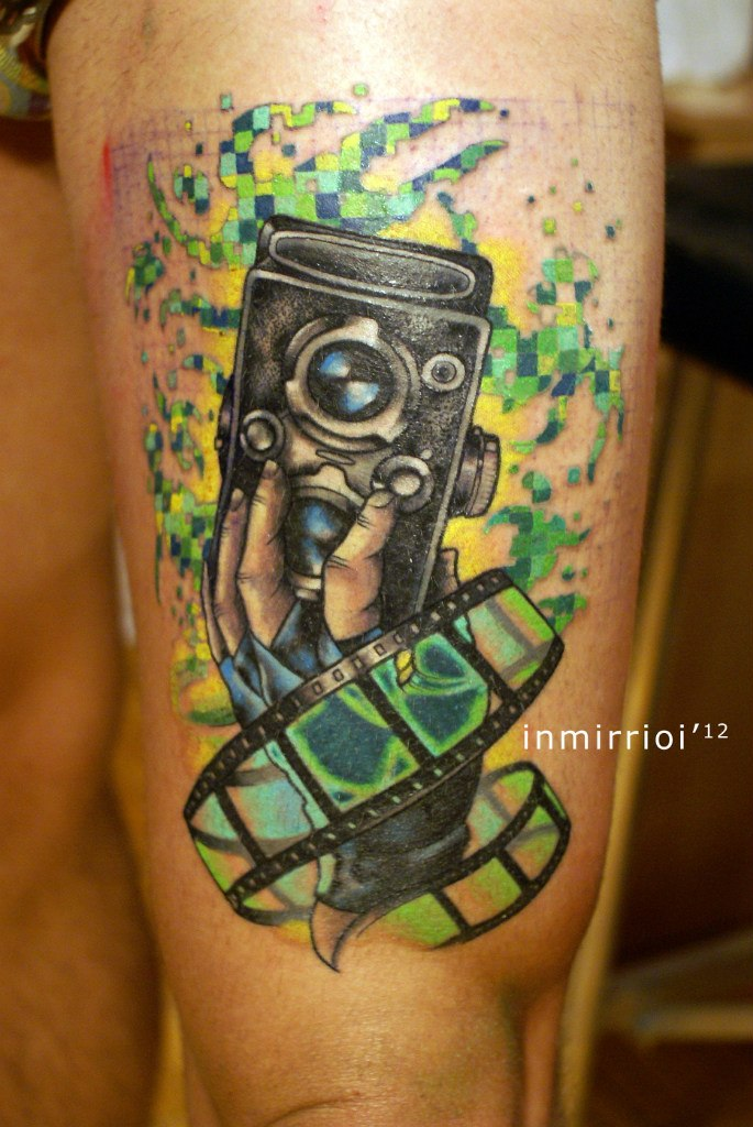 Coolest Green Blue And Black Color Ink Camera Tattoo With Film On Leg For Boys