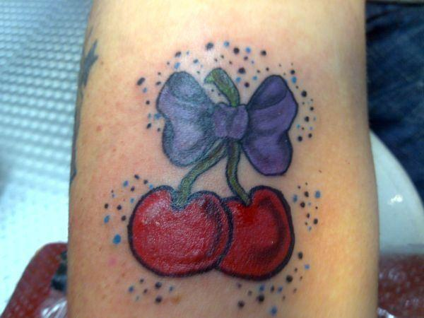 Crazy Blue Black And Red Color Ink Bow Cherries Tattoo Design On Leg For Girls