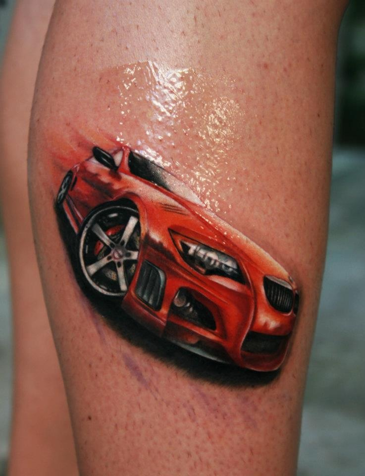 Fabulous Black And Red Color Ink Sports Car Tattoo Design On Leg For Girls