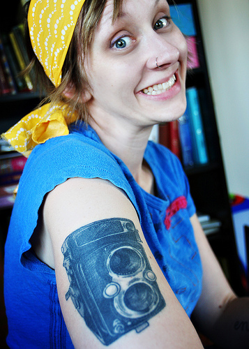 Incredible Blue Color ink Camera Tattoo On Biceps For Girls