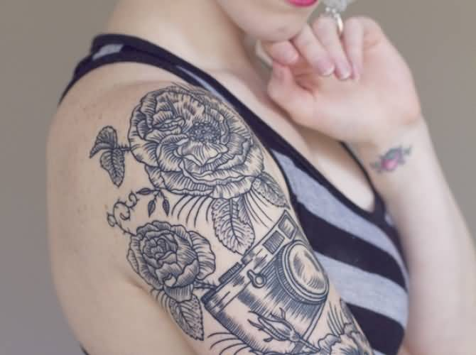 Innovative Black And Red Color Ink Flowers & Camera Tattoo On Shoulder For Women