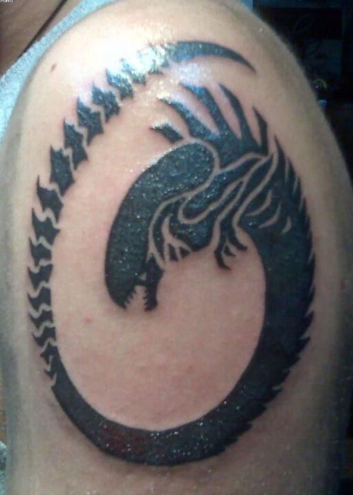 Mind Blowing Black Color Ink Alien Snake Tattoo Design On Shoulder For Boys