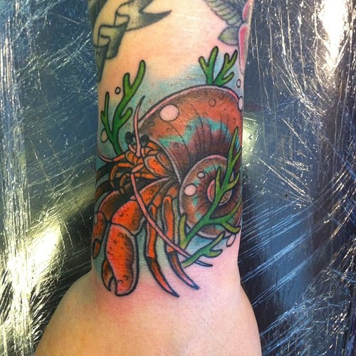 Mind Blowing Green Red And Black Color Ink Hermit Crab Tattoo Design For Girls