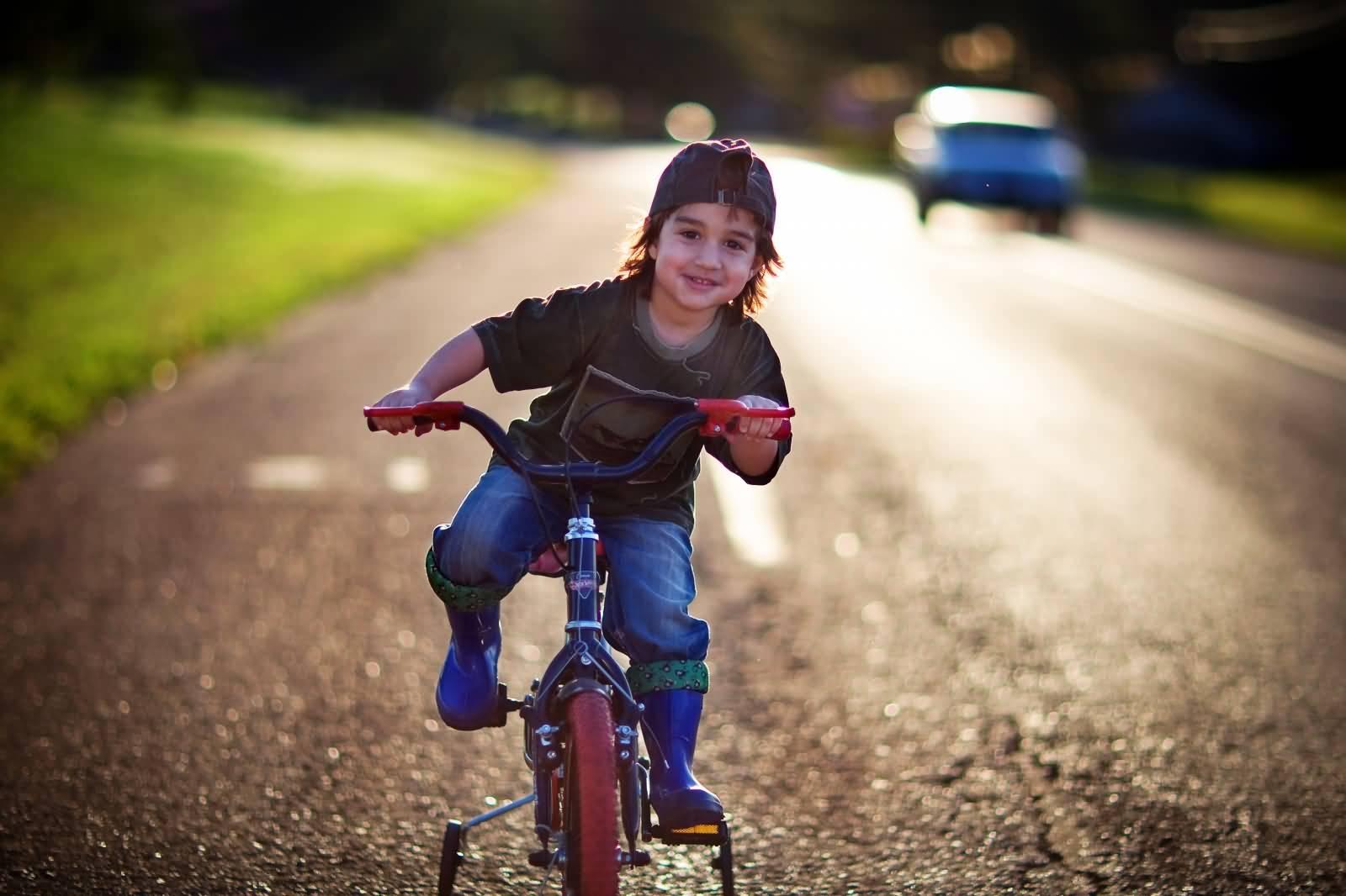 Most Wonderful Kid Driving A Bike Full HD Wallpaper
