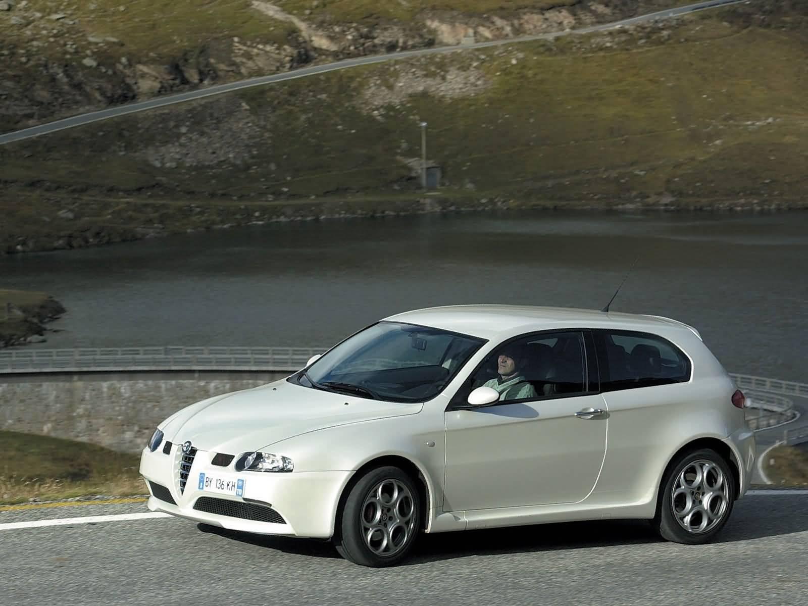 On the road of wonderful White colour Alfa Romeo 147 GTA Car