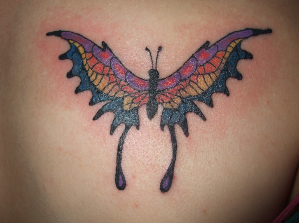 Out Standing Blue Black And Red Color Ink Butterfly Tattoo On Back For Girls