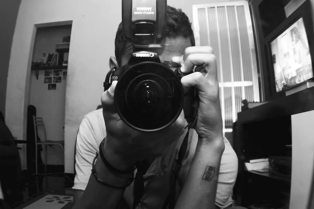 Perfect Black Color Ink Small Size Camera Tattoo On Wrist For Boys