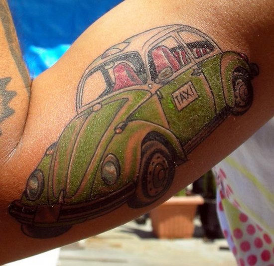 Popular Green Black And Red Color Ink Taxi Car Tattoo On Muscles For Boys
