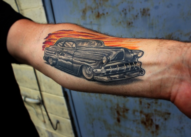 Realistic Black And Red Color Ink Black Car Tattoo On Forearm For Boys