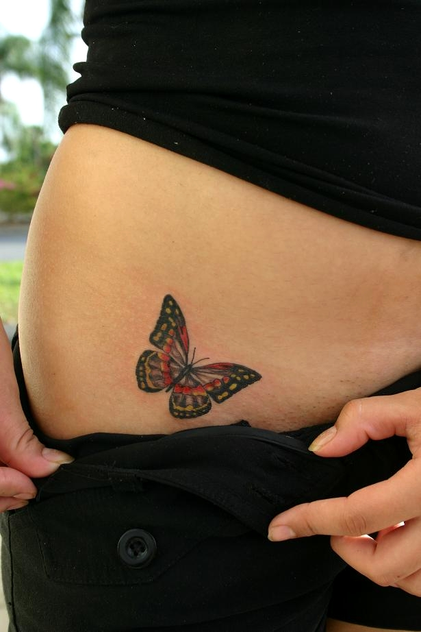 Superb Black And Red Color Ink Butterfly Tattoo On Hip For Girls