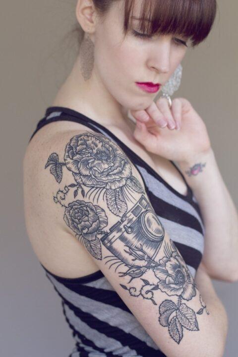 Superb Black Color Floral Vintage Camera Tattoo Design On Shoulder For Girls