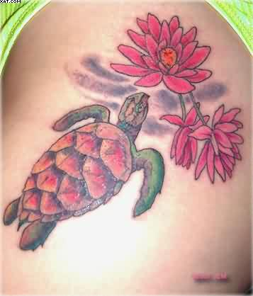 Superb Red And Green Color Ink Turtle With Flowers Aqua Tattoo On Thigh For Girls