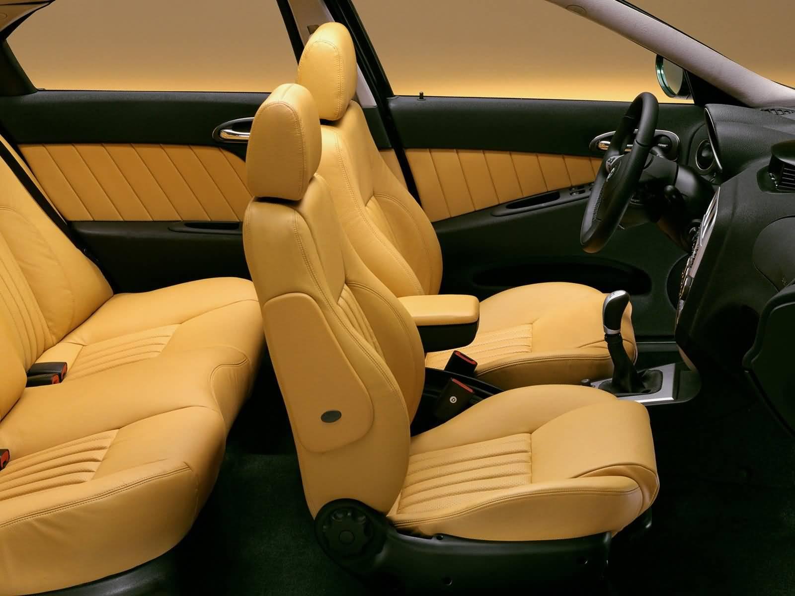 Yellow seat of awesome Alfa Romeo 156 Car