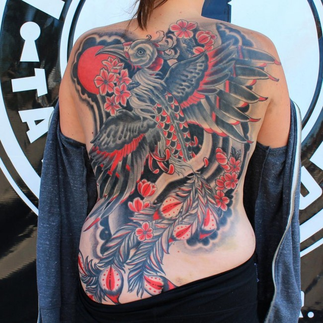 Awesome back tattoo with colorful ink for man and woman for Full lower back tattoos