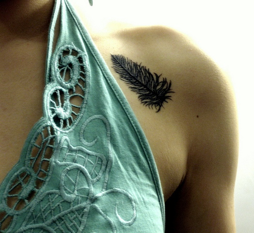 Adorable Feather Tattoo On Shoulder For Girls