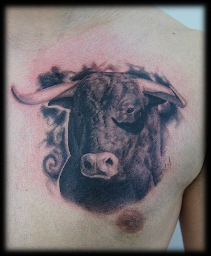 Adorable Realism Bull Head Portrait Tattoo On Chest For Boys