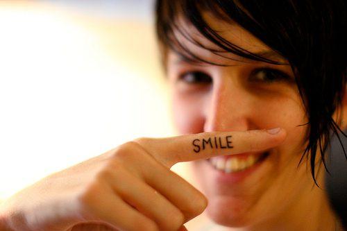 Adorable Smile Tattoo On Finger For Women Finger Tattoos