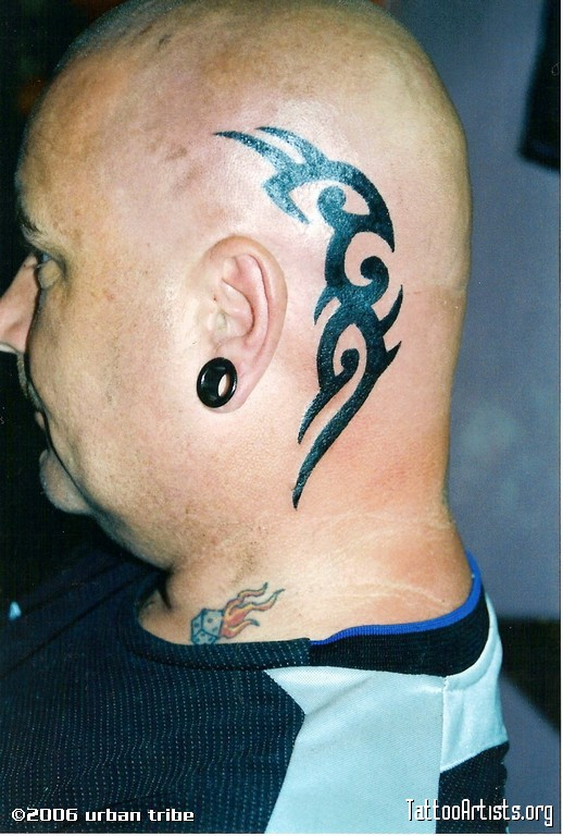 Amazing Tribal Head Tattoo Design For Boys