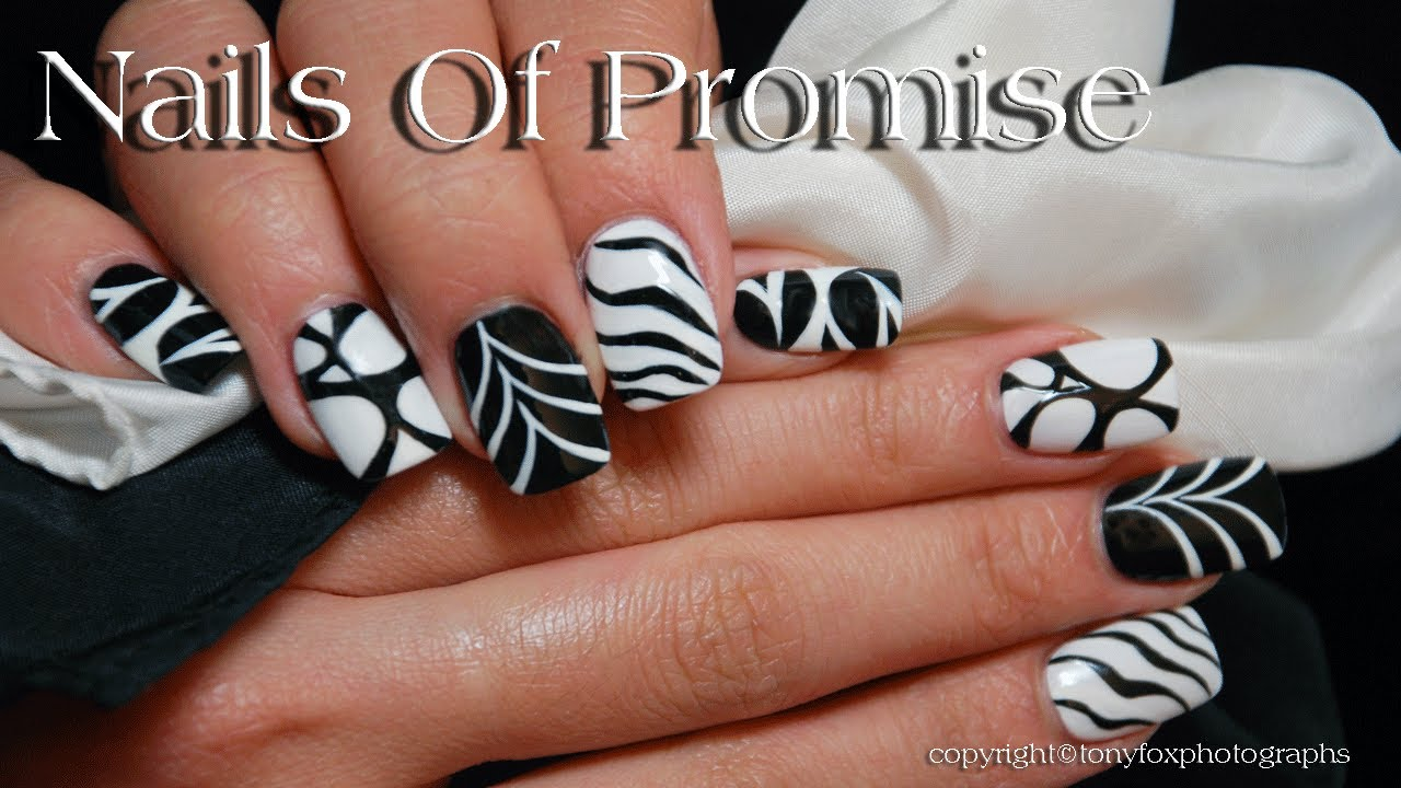 Awesome White And Black Nail Art Design With 4 Different Designs