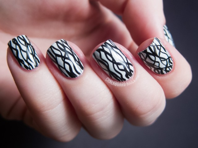 Beautiful Stripes Of Black And White Nail Art
